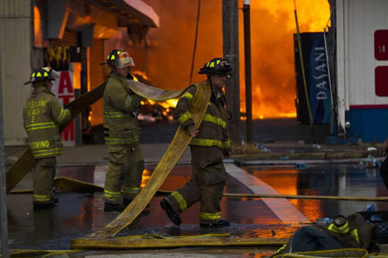 New Jersey firefighters arrive to control a massive fire in Seaside Park in New Jersey September 12, 2013. The fire engulfed several blocks of boardwalk and businesses on Thursday in Seaside Park, a shore town that was still rebuilding from damage caused by Superstorm Sandy. (Eduardo Munoz/Reuters)