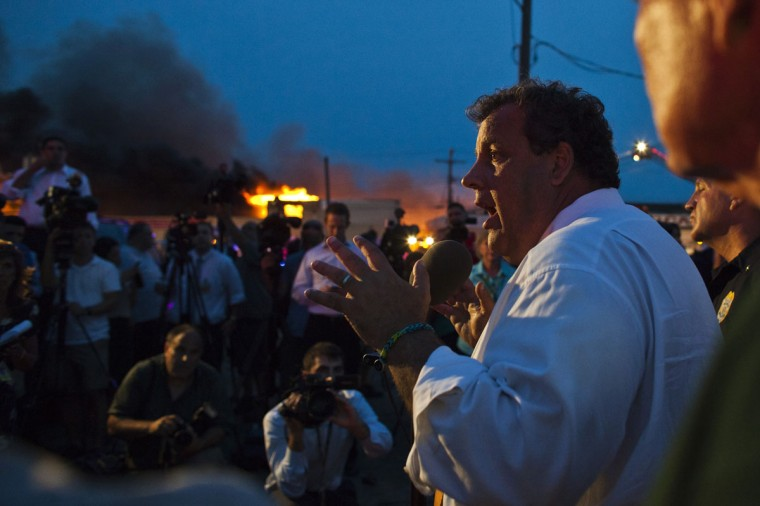New Jersey Governor Chris Christie (R) speaks with the media while firefighters work to control a massive fire in Seaside Park in New Jersey September 12, 2013. The fire engulfed several blocks of boardwalk and businesses on Thursday in Seaside Park, a shore town that was still rebuilding from damage caused by Superstorm Sandy. (Eduardo Munoz/Reuters)