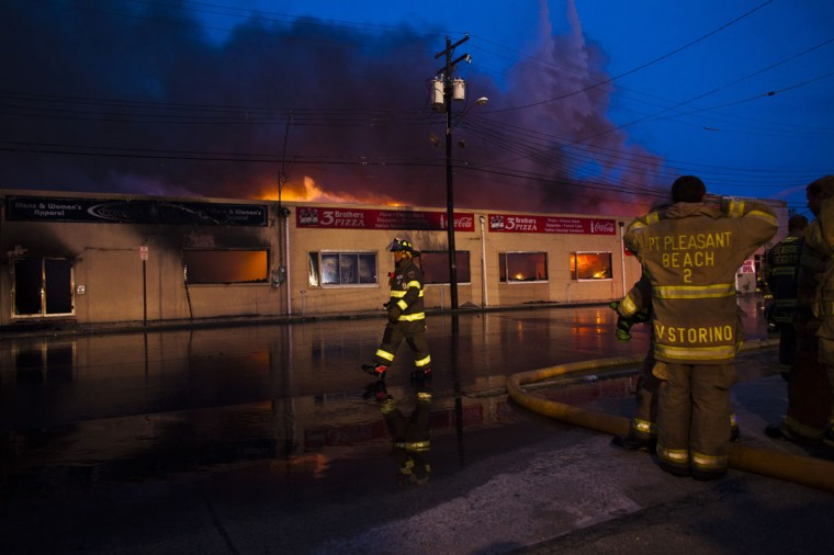 New Jersey firefighters walk near a massive fire as they work to control it in Seaside Park in New Jersey September 12, 2013. The fire engulfed several blocks of boardwalk and businesses on Thursday in Seaside Park, a shore town that was still rebuilding from damage caused by Superstorm Sandy. (Eduardo Munoz/Reuters)