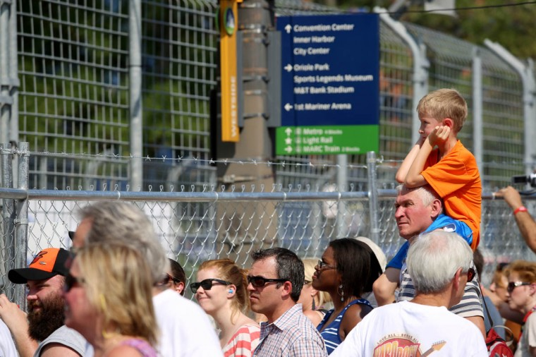 Loud noises from the Grand Prix of Baltimore cause fans to cover their ears. (Kaitlin Newman/Baltimore Sun)