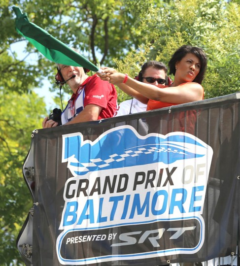 Baltimore City Mayor Stephanie Rawlings-Blake waves the flag at the Grand Prix of Baltimore. (Kaitlin Newman/Baltimore Sun)