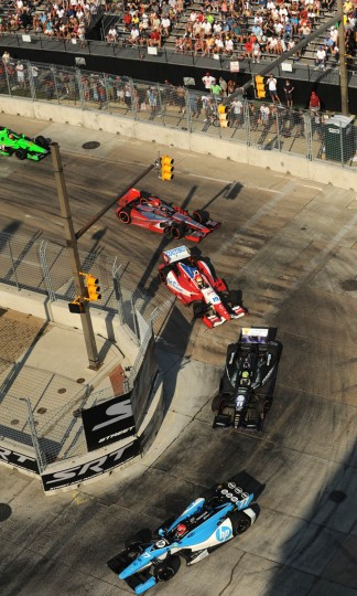 Simon Pagenaud #77, the winner of the race, , foreground, rounds turn #3. (Algerina Perna/Baltimore Sun)
