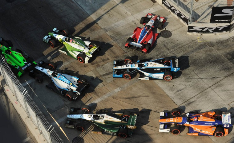 On lap 62, Justin Wilson (red car #19) gets turned around by another race car at turn #3. (Algerina Perna, Baltimore Sun)
