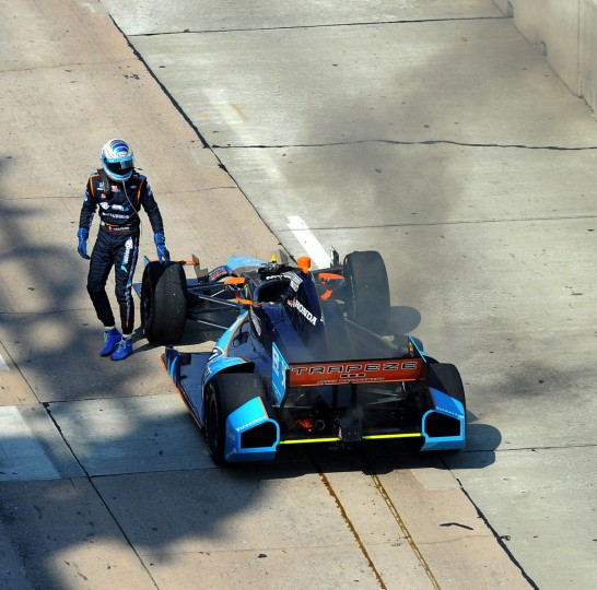 Race car driver Luca Filippi gets out of his race car after it started smoking when rounding car 3. (Algerina Perna/ Baltimore Sun)