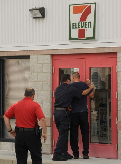 "A training exercise is performed in front of a mock ""7-Eleven"" complete with authentic sign. Algerina Perna/Baltimore Sun"