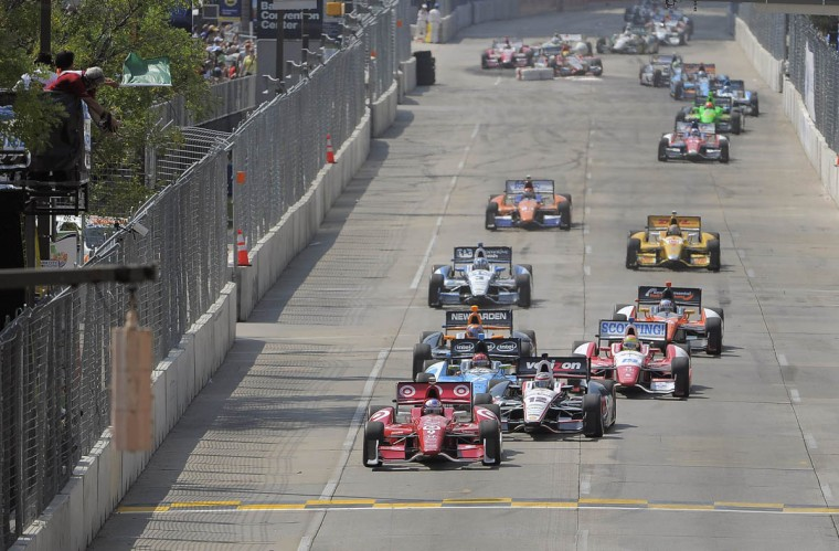 Scott Dixon, who had won the pole position (was knocked out of race) is followed by Will Power (Verizon car) at the green flag during the IZOD IndyCar Series at the 2013 Grand Prix of Baltimore. Simon Pagenaud captured the flag. (Karl Merton Ferron/Baltimore Sun)