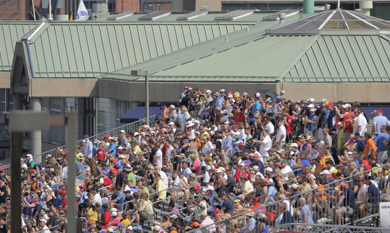 A crowd of people in the grandstands across from the Pratt Street Pavilion watch the IZOD IndyCar Series at the 2013 Grand Prix of Baltimore. Simon Pagenaud captured the flag. (Karl Merton Ferron/Baltimore Sun)