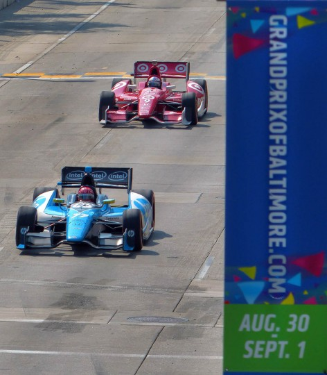 Simon Pagenaud (77) leads Scott Dixon (who was in the pole position) past the start/finish line during the IZOD IndyCar Series at the 2013 Grand Prix of Baltimore. Pagenaud captured the flag, while Dixon was knocked out of the race. (Karl Merton Ferron/Baltimore Sun)