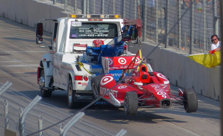Scott Dixon's Target car gets towed after being disabled by Will Power's car on the main straightaway during the IZOD IndyCar Series at the 2013 Grand Prix of Baltimore. (Karl Merton Ferron/Baltimore Sun)