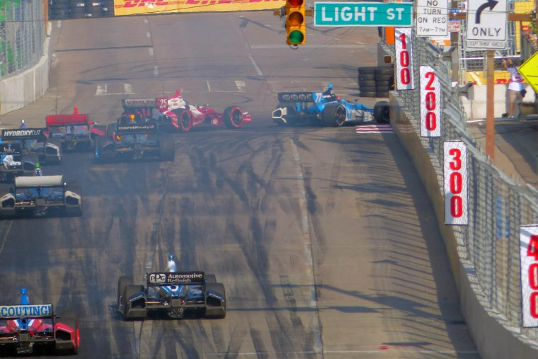 Simon Pagenaud (77) cuts inside turn one to take the lead over Marco Andretti (25) during the IZOD IndyCar Series at the 2013 Grand Prix of Baltimore. Simon Pagenaud captured the flag. (Karl Merton Ferron/Baltimore Sun)