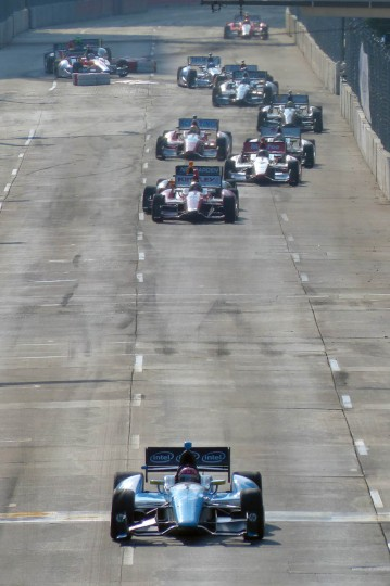 Having the lead for the first time on the straightaway, Simon Pagenaud has space between himself and the rest of the group with ten laps remaining (65 of 75) during the IZOD IndyCar Series at the 2013 Grand Prix of Baltimore. (Karl Merton Ferron/Baltimore Sun)