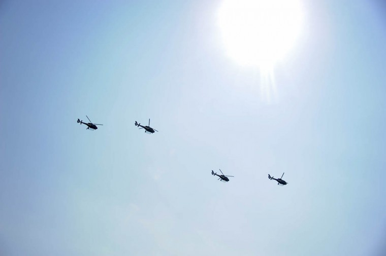 Four Baltimore Police helicopters perform a flyover during the IZOD IndyCar Series at the 2013 Grand Prix of Baltimore. (Karl Merton Ferron/Baltimore Sun)