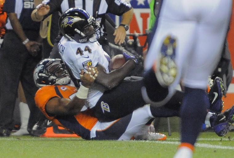 Baltimore Ravens full back Vonta Leach rolls above Denver Broncos linebacker Wesley Woodyard for a touchdown Thursday, Sep. 5, 2013. Baltimore Ravens vs. Denver Broncos NFL football at Mile High Stadium. (Karl Ferron/Baltimore Sun)