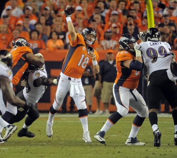 Broncos quarterback #18 Peyton Manning throws a second quarter pass. Baltimore Ravens vs. Denver Broncos NFL football at Mile High Stadium. (Karl Merton Ferron/Baltimore Sun)