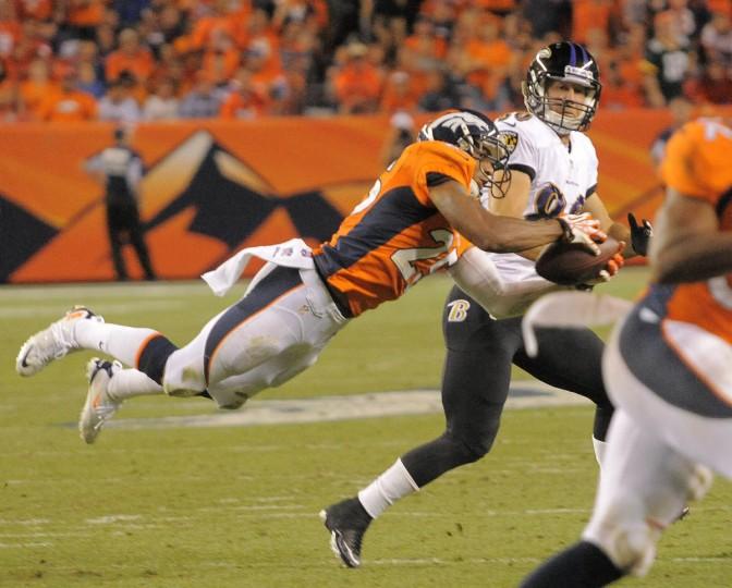 Broncos #25 Chris Harris intercepts a pass intended for Ravens #80 Brandon Stokley in the second quarter. Baltimore Ravens vs. Denver Broncos NFL football at Mile High Stadium. (Karl Ferron/Baltimore Sun)