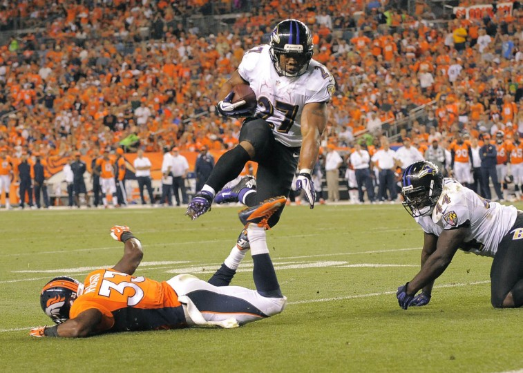 Ravens' #27 Ray rice scores a second quarter touchdown. Baltimore Ravens vs. Denver Broncos NFL football at Mile High Stadium. (Karl Ferron/Baltimore Sun)