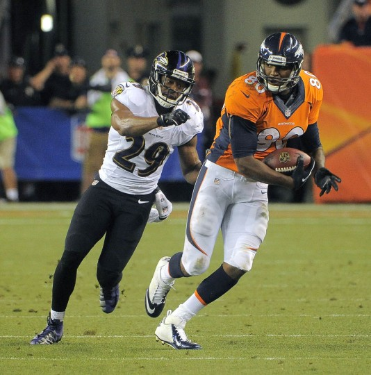 Denver Broncos tight end Julius Thomas (80) breaks free of Baltimore Ravens free safety Michael Huff (29) for a large gain that sets up a touchdown Thursday, Sep. 5, 2013. Baltimore Ravens vs. Denver Broncos NFL football at Mile High Stadium. (Karl Ferron/Baltimore Sun)