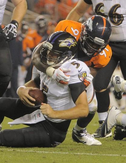 Broncos #91 Robert Ayers sacks Ravens quarterback #5 Joe Flacco in the second quarter. Baltimore Ravens vs. Denver Broncos NFL football at Mile High Stadium. (Karl Merton Ferron/Baltimore Sun)