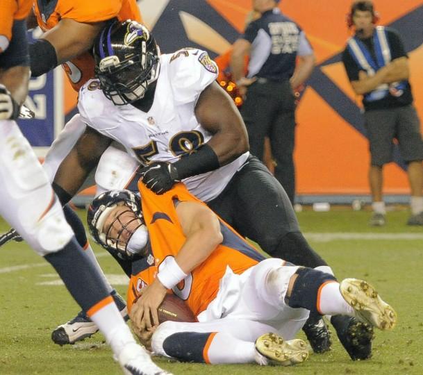 Baltimore Ravens linebacker Elvis Dumervil (58) sacks his old teammate, Denver Broncos quarterback Peyton Manning (18) Thursday, Sep. 5, 2013. Baltimore Ravens vs. Denver Broncos NFL football at Mile High Stadium. (Karl Ferron/Baltimore Sun)