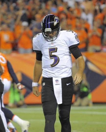 Ravens' #5 Joe Flacco after being sacked in the third quarter. Baltimore Ravens vs. Denver Broncos NFL football at Mile High Stadium. (Karl Merton Ferron/Baltimore Sun)