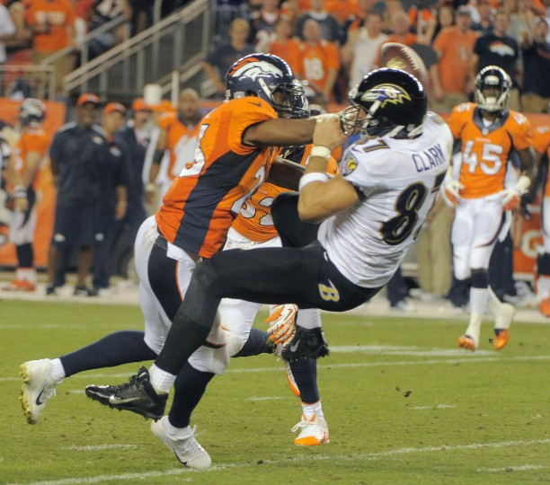 Denver Broncos free safety Rahim Moore lights up Baltimore Ravens tight end Dallas Clark (87), which jars an attempted pass free Thursday, Sep. 5, 2013. Baltimore Ravens vs. Denver Broncos NFL football at Mile High Stadium. (Karl Ferron/Baltimore Sun)