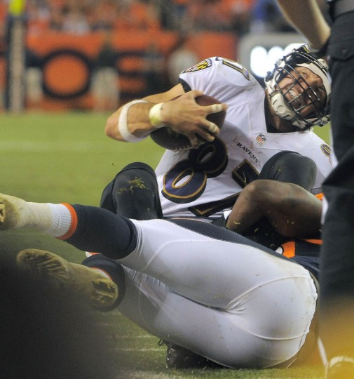 Baltimore Ravens tight end Dallas Clark is stopped by Denver Broncos linebacker Danny Trevathan after a short gain during the third quarter at Mile High Stadium. (Karl Merton Ferron/Baltimore Sun)