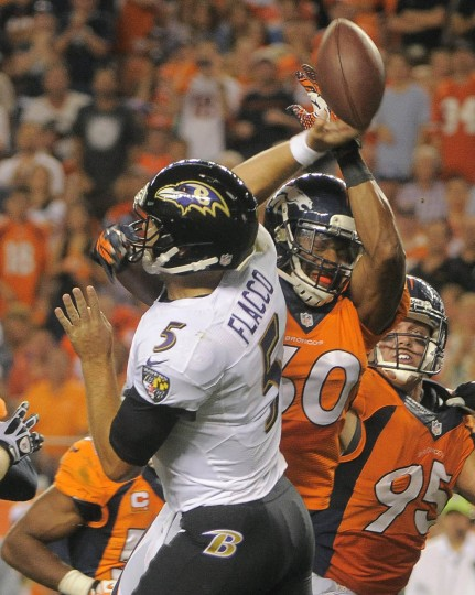 Ravens' quarterback #5 Joe Flacco has his pass knocked down by Broncos #60 Steve Vallos in the third quarter. Baltimore Ravens vs. Denver Broncos NFL football at Mile High Stadium. (Karl Ferron/Baltimore Sun)