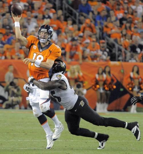 Baltimore Ravens linebacker Terrell Suggs (55) wraps around Denver Broncos quarterback Peyton Manning (18) who throws the ball away during the third quarter at Mile High Stadium. (Karl Merton Ferron/Baltimore Sun)