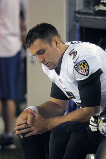 Baltimore Ravens quarterback Joe Flacco (5) sits on the bench during the fourth quarter at Mile High Stadium. (Karl Merton Ferron/Baltimore Sun)