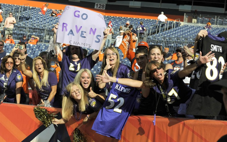 Ravens fans that made the trip to Denver, cheer the ravens players as the arrive on the field for pregame warm ups. Baltimore Ravens vs Denver Broncos NFL football at Sports Authority Field at Mile High Stadium. (Lloyd Fox/Baltimore Sun)