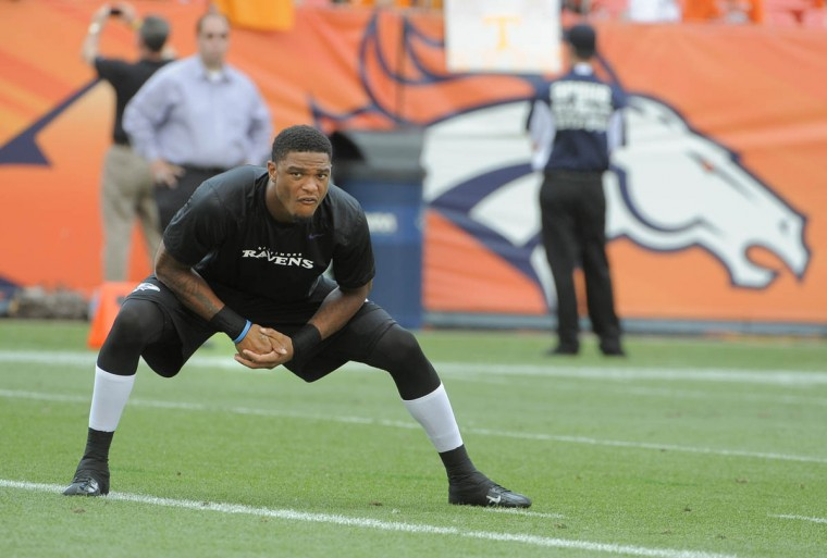 Ravens' Jimmy Smith stretches prior to the Ravens-Broncos game. Baltimore Ravens vs Denver Broncos NFL football at Sports Authority Field at Mile High Stadium. (Lloyd Fox/Baltimore Sun)
