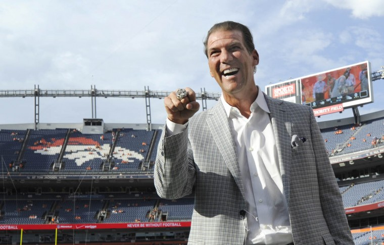 Ravens' owner Steve Bisciotti shows off his Ravens' Super Bowl ring to the fans before the game. Baltimore Ravens vs Denver Broncos NFL football at Sports Authority Field at Mile High Stadium. (Lloyd Fox/Baltimore Sun)