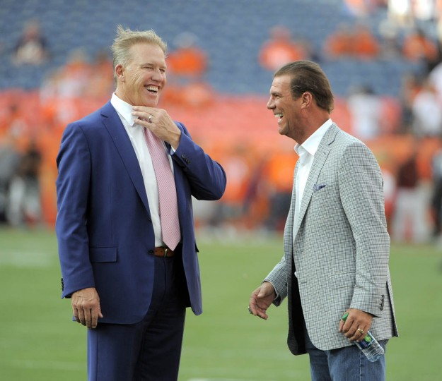 John Elway, left, and Ravens' owner Steve Bisciotti share a laugh before the game. Baltimore Ravens vs Denver Broncos NFL football at Sports Authority Field at Mile High Stadium. (Lloyd Fox/Baltimore Sun)