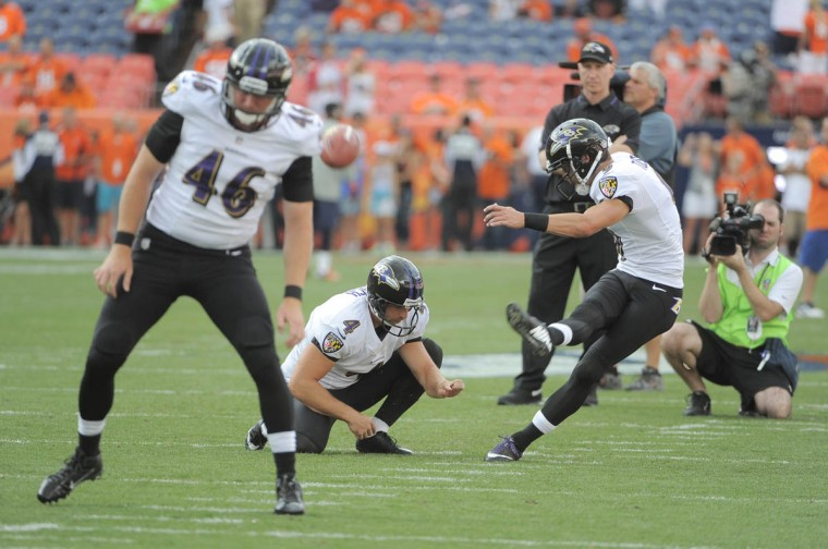 Justin Tucker the Ravens' kicker takes a few practice field goals attempts before the game. Baltimore Ravens vs Denver Broncos NFL football at Sports Authority Field at Mile High Stadium. (Lloyd Fox/Baltimore Sun)