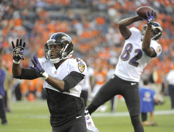 Ravens #24 Corey Graham and #82 Torrey Smith work on catching balls during pregame warmup. Baltimore Ravens vs Denver Broncos NFL football at Sports Authority Field at Mile High Stadium. (Lloyd Fox/Baltimore Sun)
