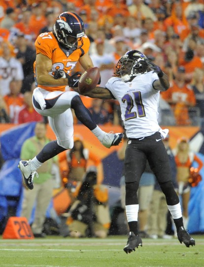 Ravens #21 Lardarius Webb knocks the ball away from Broncos #87 Eric Decker in the first quarter. Baltimore Ravens vs Denver Broncos NFL football at Sports Authority Field at Mile High Stadium. (Lloyd Fox/Baltimore Sun)