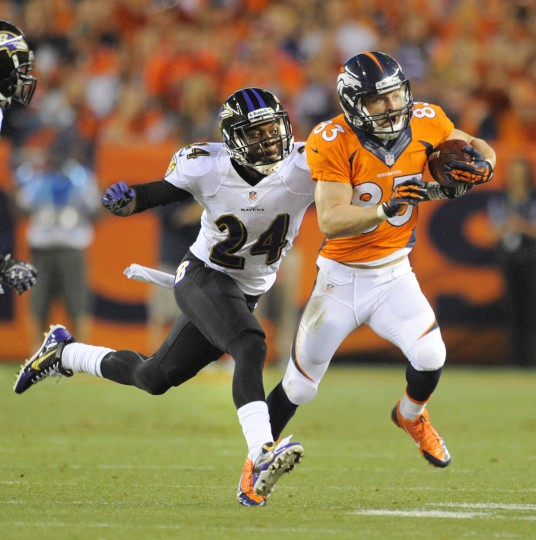 Ravens #24 Corey Graham chases Broncos #83 Wes Welker in the first quarter. Baltimore Ravens vs Denver Broncos NFL football at Sports Authority Field at Mile High Stadium. (Lloyd Fox/Baltimore Sun)