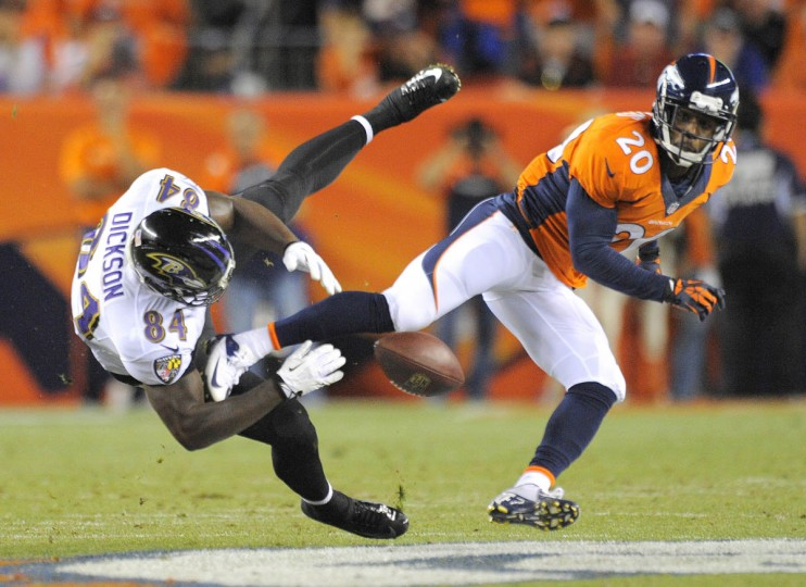 Ravens' #84 Ed Dickson drops a pass in the first half as Broncos #20 Mike Adams was in on the play. Baltimore Ravens vs Denver Broncos NFL football at Sports Authority Field at Mile High Stadium. (Lloyd Fox/Baltimore Sun)
