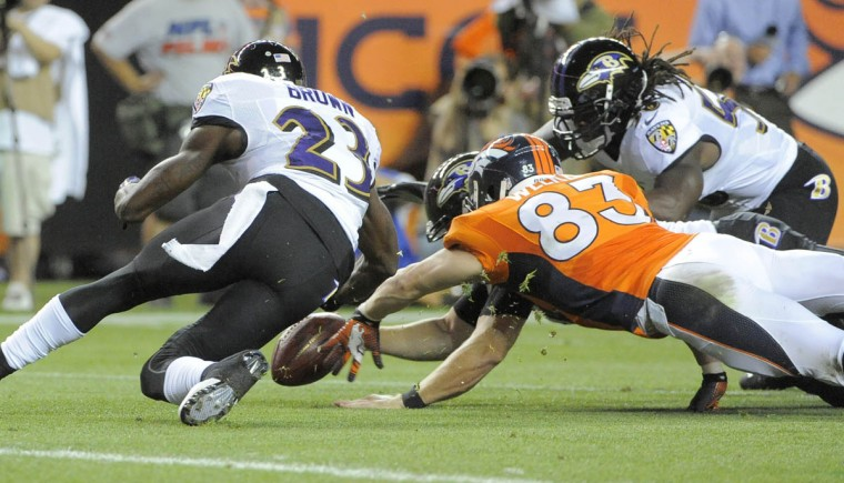 Ravens' #23 Chykie Brown recovers a second quarter fumble by Broncos #83 Wes Welker on a Ravens punt. Baltimore Ravens vs Denver Broncos NFL football at Sports Authority Field at Mile High Stadium. (Lloyd Fox/Baltimore Sun)