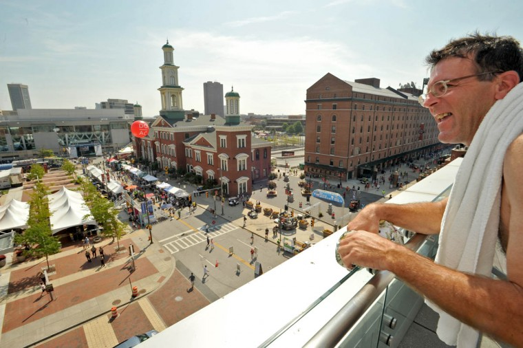 Larry Baldyga of Fairfield, CT, watches the Grand Prix scene from the Hilton Convention Center hotel after enjoying a sauna before the main races. (Amy Davis /Baltimore Sun)