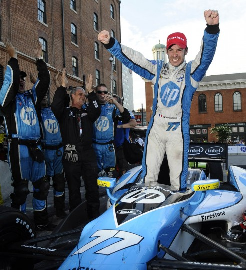 Simon Pagenaud, winner of the 2013 Grand Prix of Baltimore, celebrates after getting out of his Schmidt Hamilton race car at pit lane. (Kenneth K. Lam/Baltimore Sun)