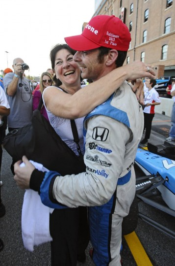 Simon Pagenaud, right, winner of the 2013 Grand Prix of Baltimore, celebrates with his mother Sylvie, left, after getting out of his Schmidt Hamilton race car at pit lane. (Kenneth K. Lam/Baltimore Sun)