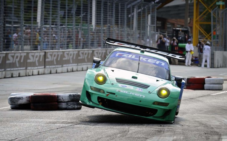 The Falken Porsche 911 GT3 RSR car gets airborne after going over a chicane near Howard street during qualifying run for the ALMS GT class at the Grand Prix of Baltimore Aug. 30, 2013. (Kenneth K. Lam/Baltimore Sun)