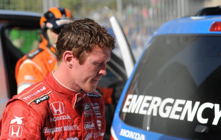 Scott Dixon heads for a support vehicle after crashing out of the Grand Prix of Baltimore on lap 53. (Jerry Jackson/Baltimore Sun)