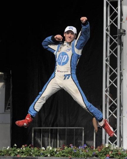 Indy Car winner Simon Pagenaud celebrates his victory in the winner's circle. (Lloyd Fox/Baltimore Sun)