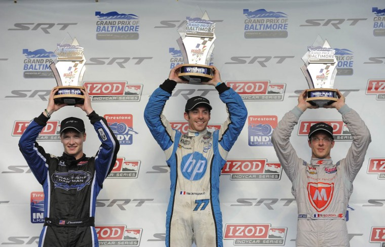 Indy Car Grand Prix winners, left to right, Josef Newgarden the second place finisher, Simon Pagenaud the winner and Sebastien Bourdais who finished third stand in winner's circle. (Lloyd Fox/Baltimore Sun)