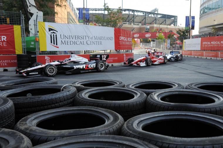 Indy cars going around turn 12. (Lloyd Fox/Baltimore Sun)