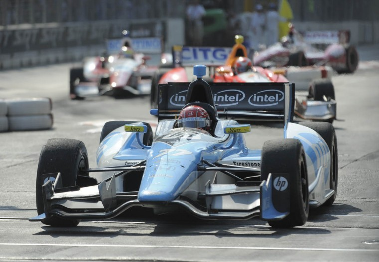 Simon Pagenaud driving the #77 car during a caution lap. (Lloyd Fox/Baltimore Sun)