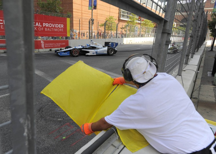Indy cars driving through turn 12 during a caution lap. (Lloyd Fox/Baltimore Sun)