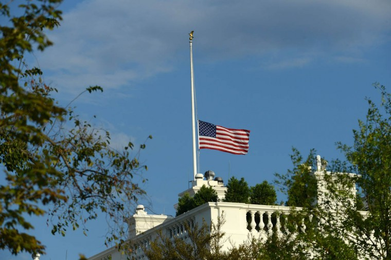 The American flag atop the White House is lowered to half-staff on Monday, September 16, 2013, following the shooting that killed at least 12 people at the Navy Yard in Washington, D.C. (Olivier Doulier/Abaca Press/MCT))
